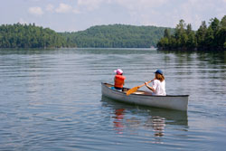 a mother and child in a boat on a lake